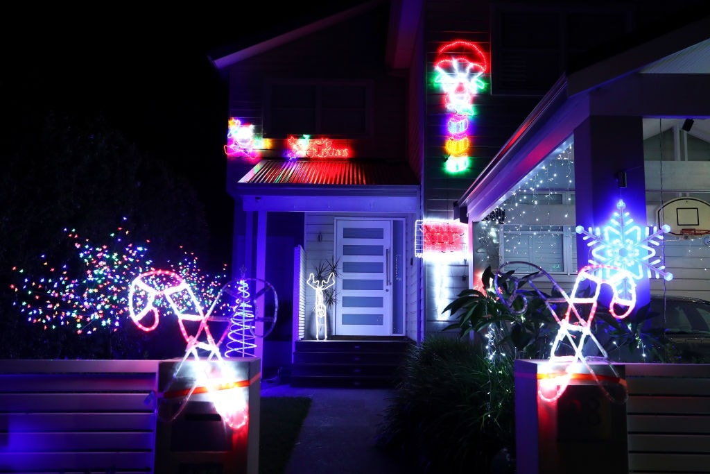 A Woman Put Christmas Lights On Her Roof In The Shape Of
